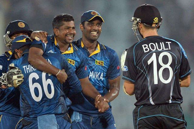 Rangana Herath of Sri Lanka celebrates with teammates after dismissing Trent Boult of New Zealand.